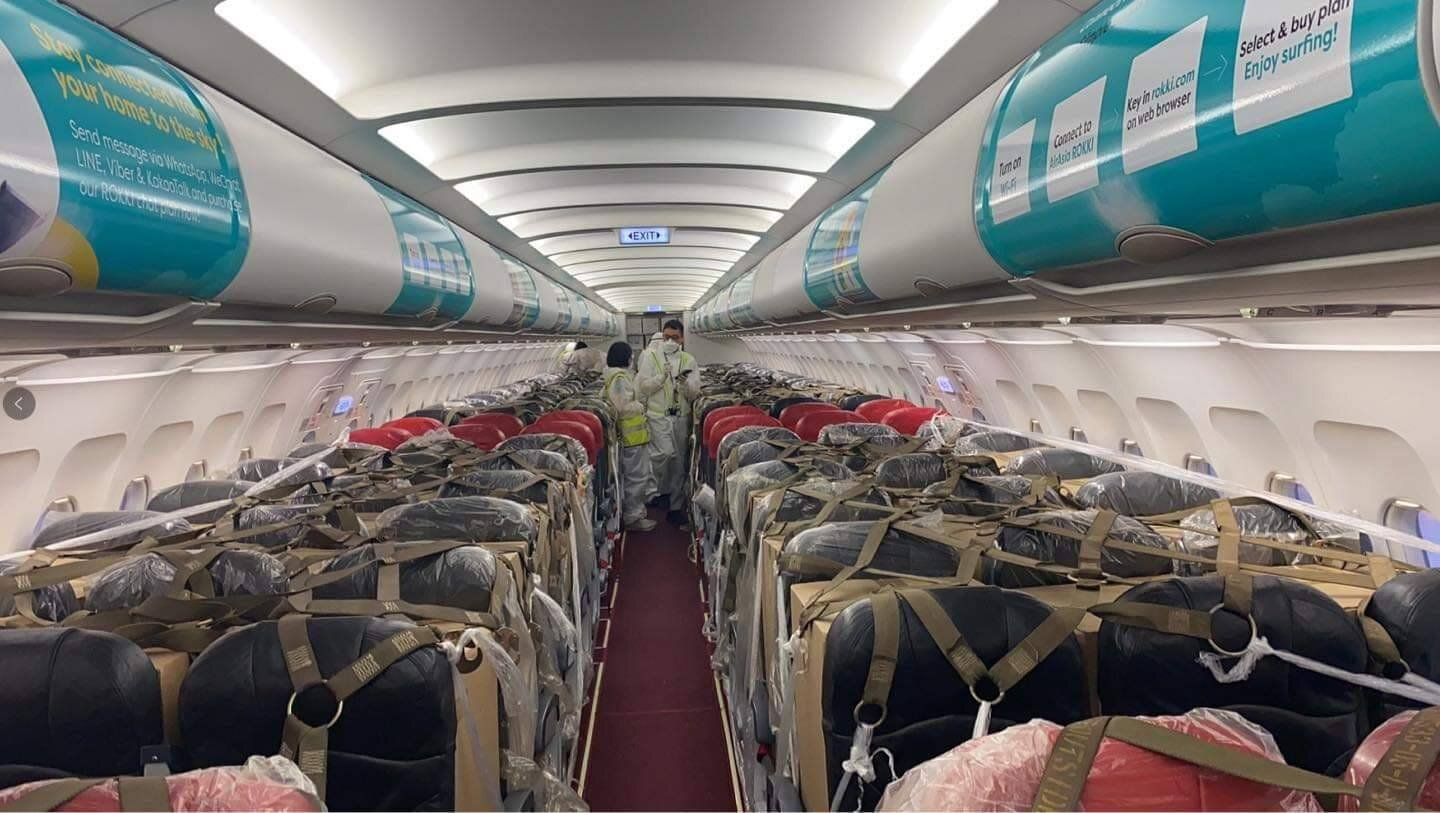 Boxes of cargo were safely stowed in overhead compartments, as well as on and underneath passenger seats. Safety harnesses and nets were installed in the cabin to secure all cargo
