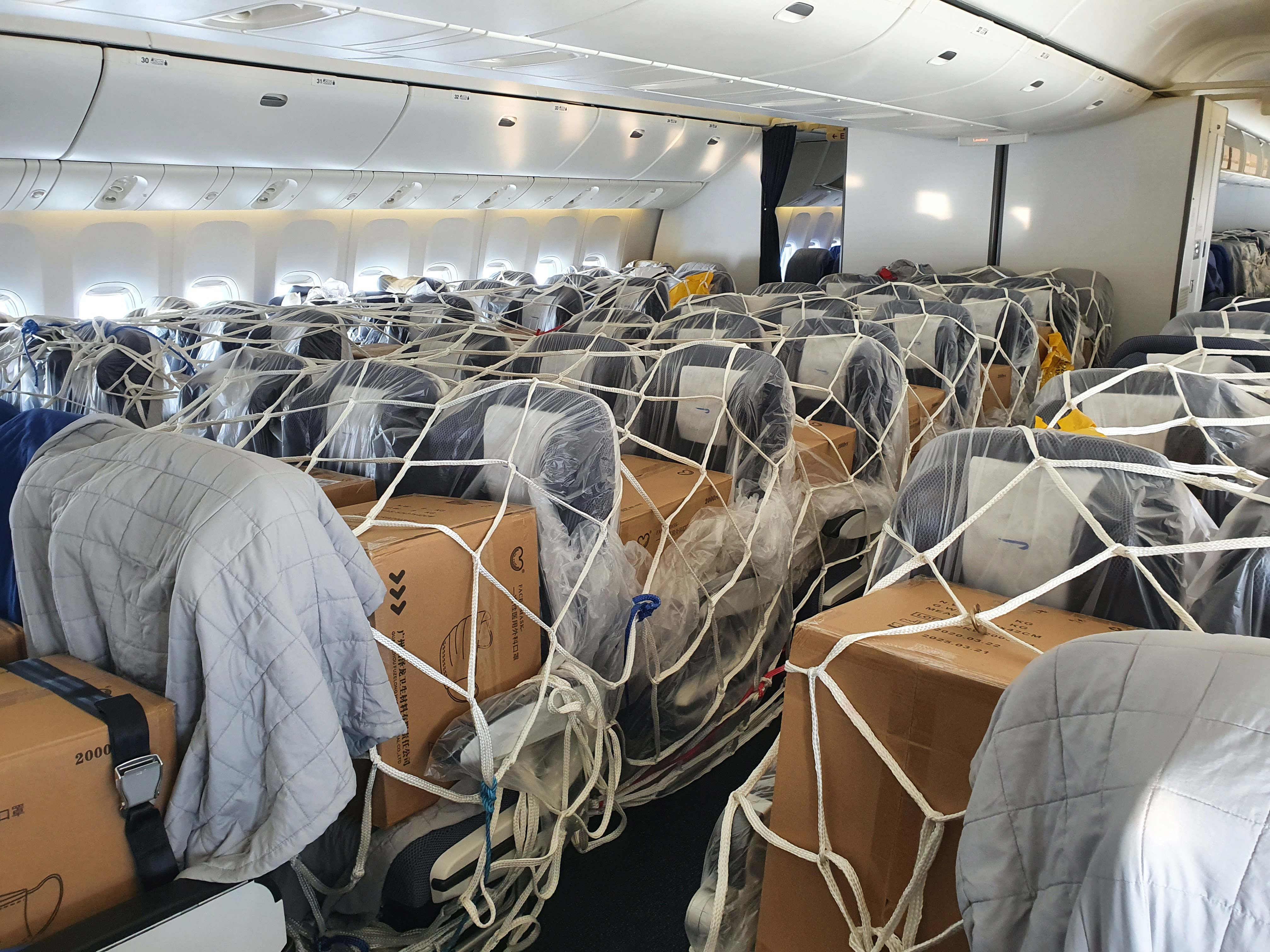 IAG Cargo and British Airways work together to expand aircraft cargo capacity with use of passenger cabins, as seen in this shipment of essential PPE equipment for the NHS which landed in the UK this week