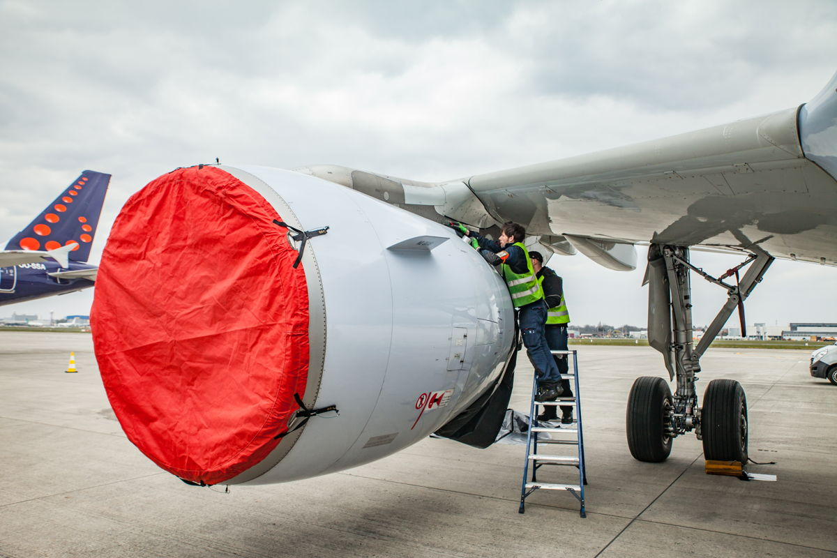 Brussels' Maintenance and Engineering staff preparing the aircraft for staying landed.