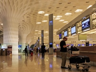 India's Adani Group to pick 74% stake in Mumbai International Airport