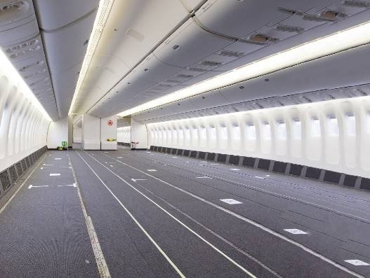 Passenger seats leave the plane, cargo crowds the cabin