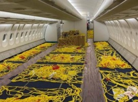 Any cargo flying on board will be held in place with netting fastened to floor rails where the seats were anchored.